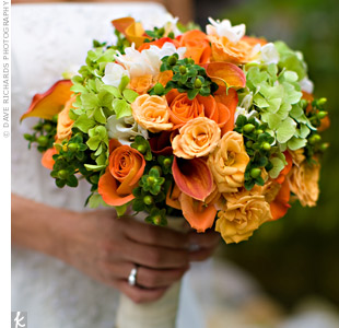 Hydrangeas and freesia are two of Ann-Marie's favorite flowers, so she carried them in her orange-and-green bouquet, along with coffee beans, spray roses, and calla lilies.