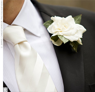 Tom loves Aimee's gardenia-scented perfume so much he chose the flower for his boutonniere.