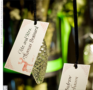 Guests' names were attached to glass pinecones, which were reminiscent of the cones Aimee found during Tom's ski trip proposal. The pinecones doubled as favors.