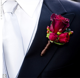 Chris sported a rich cluster of roses and hypericum berries on his lapel.