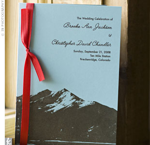 Brooke screen-printed the programs by hand with a blue-and-brown mountain motif that matched the invitations, and bound them with red ribbon.