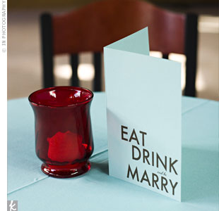 "Brooke designed the dinner and cocktail menus herself, screen printing the phrase ""Eat, Drink and be Marry"" onto blue cardstock she found at a local paper store."