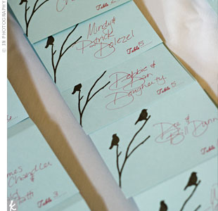 Little brown songbirds hovered over each guest's name on pale blue escort cards.