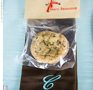 "The morning of the wedding, Brooke's mom baked and packaged five dozen cookies for guests. ""She said it really calmed her nerves,"" says Brooke. Kraft paper tags printed with the French phrase, Merci beaucoup (many thanks), personalized the bags."