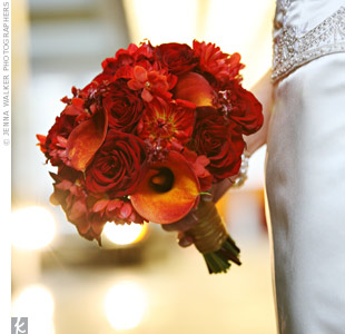 For a romantic autumn look, Kristi carried a bouquet of burnt orange calla lilies, deep red dahlias, roses and oncidium orchids with rosemary accents.