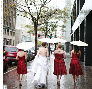 The bridesmaids strapless tea-length gowns matched the deep berry color in the wedding details. Three repeated layers of chiffon, charmeuse and lace lent to the romantic feel of the day.