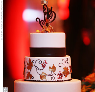 A chocolate version of the couple's grapevine motif topped their three-tiered cake. Fondant and sugar leaves in shades of berry and gold added three-dimensional texture to the confection.
