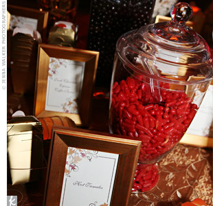 The couple had fun picking out the red and gold goodies for their candy buffet. They presented the sweets in various glass canisters and even gave guests little gold to-go boxes.