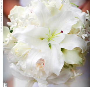 Roses, lilies, stephanotis and orchids made up Haley's classic all-white bouquet. For a sentimental touch, she attached her grandmother's locket with baby pictures of her and Jamie inside.