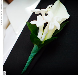 The groom donned a calla lily and stephanotis to match the bride's crisp white bouquet.