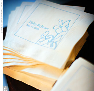 Cream cocktail napkins detailed with the couple's signature blue floral motif also featured their wedding date.