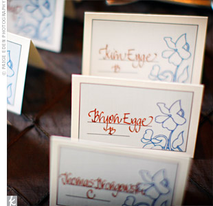 Hand-calligraphed escort cards that matched the rest of the floral stationery were displayed around a small tree in the foyer.