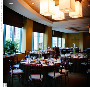 Brown linens topped the guest tables inside the contemporary Westin Tabor Center, which was filled with a combination of natural and candle light.