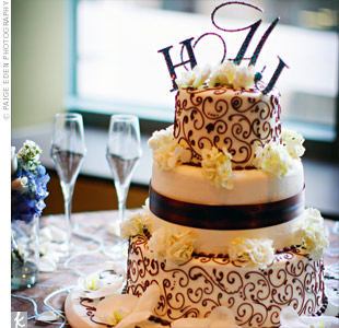 Haley and Jamie cut a three-tiered cake covered in a chocolate brown floral pattern and topped with a sparkling crystal monogram.