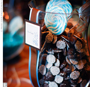 The self-serve candy bar was a big hit with guests. The couple provided personalized take-out boxes so everyone could take home a batch of blue and brown candies.