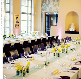 Purple up-lighting, soft mint green table runners and aubergine napkins subtly complemented the surrounding artwork and bright yellow arrangements.