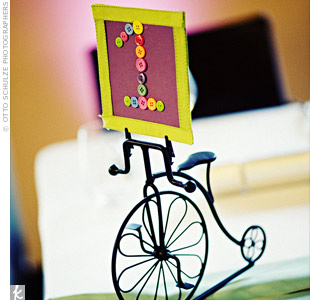 The couple's consultants found miniature bike sculptures and used them as the bases for the table numbers. Tiny buttons spelled out each number on pieces of colorful cardstock.