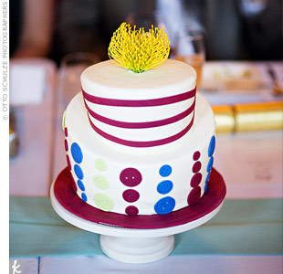Small two-tiered cakes served double-duty as centerpieces and dessert! Each confection was adorned with colorful fondant buttons in different shapes and sizes and topped with a pincushion protea bloom.