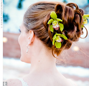 Beth's hairstylist curled her hair and twisted it into sections, securing each piece with a hairpin. For a natural touch, she added three white orchids the couple's florist had provided.