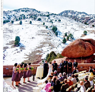A snowstorm hit two days before the wedding, covering the rust-colored boulders. With the dramatic Rocky Mountain foothills as a backdrop, the ceremony required sparse décor: curly willow branches in glass vases at the altar and ivory flower petals on the aisle.