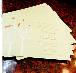 The invitations' simple motif, brown birds and a bare white tree, reflected the wedding's outdoor setting