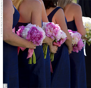 The bridesmaids carried nosegays of the same deep and light pink peonies used in Betsy's bouquet. The finishing touch: a pink satin ribbon.