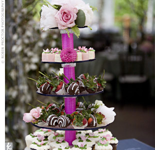 Instead of a traditional wedding cake, the couple opted for a trio of desserts: cupcakes, fruit petit fours and strawberries dipped in chocolate.