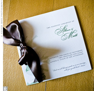 Green text and brown ribbon brought out the wedding's signature colors. The programs also had the recurring motif: two birds sitting on a branch.