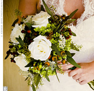 Allison carried a bouquet of roses, hydrangeas and Queen Anne's lace with seeded eucalyptus, hypericum berries and rosemary accents. She made it extra-special by wrapping it in a handkerchief her grandmother gave her.