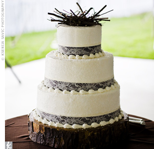 Lace and satin ribbons decorated the bottom of each buttercream-covered, sugar-crystaled tier. For the topper, Allison bought a bird's nest made of real sticks and placed three tiny plastic eggs inside it to coordinate with the stationery.