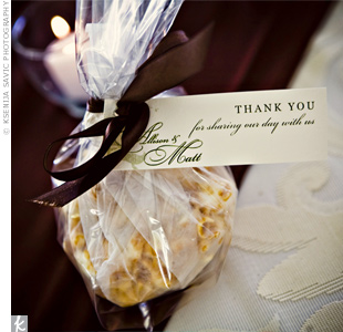 The couple wanted to give out homemade favors, so they sent guests home with the caramel popcorn balls Allison's mom makes every fal -- a great midnight snack. They were wrapped in cellophane, and satin bows polished the look.