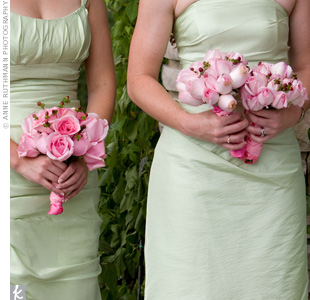 The bridesmaids carried pink roses with sprays of hypericum berries added for texture. The bouquets popped against the green dresses.