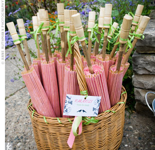 A basket of pink parasols amped up the wedding décor and shaded guests at the outdoor ceremony.