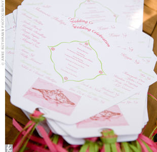 Kayu designed the ceremony programs that also served as fans to keep guests cool on the warm day. Shannon tied on green and pink streamers to bring in the colors and add a whimsical touch.