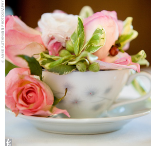To incorporate the garden into the ballroom reception—and for a sweet touch—teacups held pink roses, instead of tea, on tables.