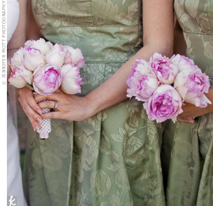Amy's bridesmaids held bouquets of pink peonies that fit the soft color palette and complemented their sage-green dresses.