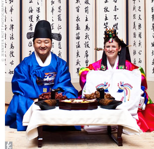 During the wedding reception, Amy and Lawrence had a Korean paebaek, where they dressed in traditional clothes and bowed to their elders as a sign of respect.