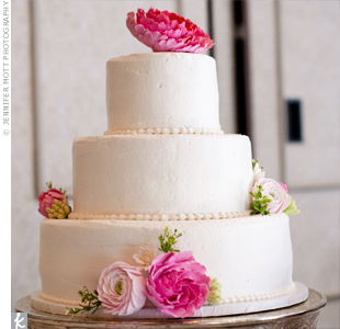 Instead of adding fresh blooms to their buttercream-frosted cake, Amy and Lawrence opted for clay ones. They took them home after the wedding as colorful keepsakes.