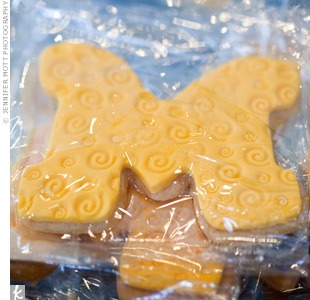 "Lawrence chose to give guests sugar cookies shaped like the letter ""M"" in maize and blue in honor of their alma mater, the University of Michigan."