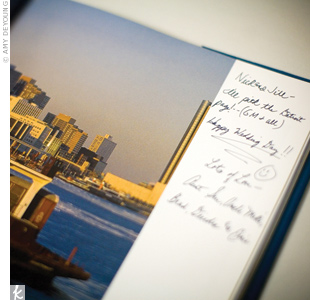 For a guest book with a Michigan twist and extra practical use, Jill and Nick asked everyone to write notes on the pages of a coffee-table book all about the state.