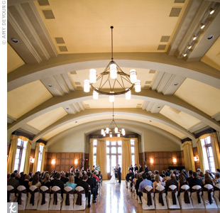 The afternoon ceremony took place in The Michigan Leagues ballroom, which gets beautiful natural lighting. Chair covers and chocolate-brown sashes kept the d&#233;cor simple and elegant.
