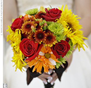 Mara and her maid of honor drove to a few grocery stores the day before the wedding to buy sunflowers, roses and mums for her DIY bouquet.