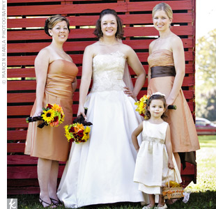 Both of Mara's bridesmaids lived out of state, so she sent them pictures of eight Bill Levkoff dresses and told them to pick the one they wanted and order it in burnt orange taffeta. Mara's mom added a leaf-print sash to the flower girl's satin dress so she'd fit the fall theme.
