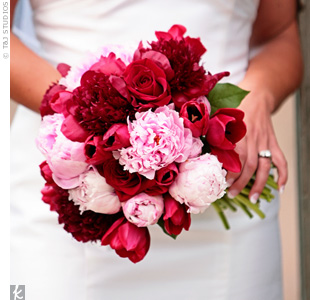 "Bright red tulips and roses added texture to Ashley's bouquet of red and pink peonies. ""I was so excited to find out May is a great month for peonies,"" says the bride."
