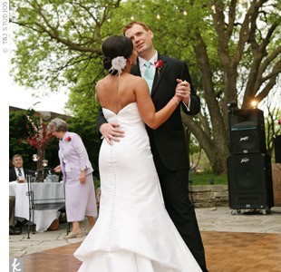 "The newlyweds danced to one of the bride's favorite tunes—Marc Cohen's ""True Companion."""