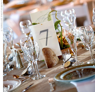 Love quotes were printed on neutral table numbers, which were placed in quarter rounds of rustic French bread.