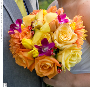 Because Asheley loves bright colors, she asked her florist to use a mix of yellow roses and tulips, orange dahlias and roses, and pink dendrobium orchids in her bouquet.