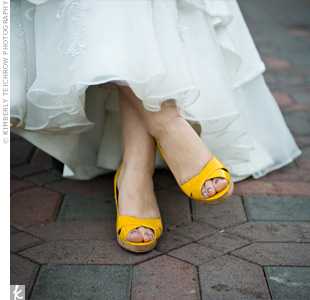 Although Asheley isn't a big fan of wedges, she knew they were a must for the outdoor wedding. She looked all over until she found these bright-yellow ones to match her color scheme.