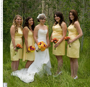 Asheley let her bridesmaids pick out their own yellow dresses. Coincidentally, three of them chose the same Empire-waist, knee-length one.