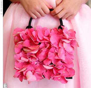 Jenny's 7-year-old cousin carried a floral purse that matched the wreath of roses, hydrangeas and wax flowers she wore in her hair.